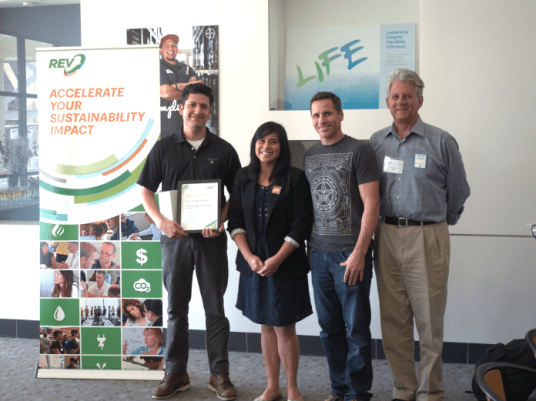 Daniel Alvarez and Pete Schreiber of Pixar receive their certificate of completion from Dianne Martinez, Mayor of Emerville.