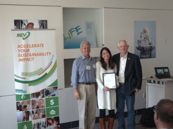 Katie Van Dyke of the City of Berkeley receives a certification of completion from Tom Bates, Mayor of Berkeley.