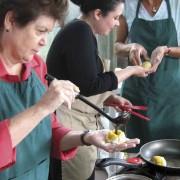 Classmates Dianne Carofino (left) and Paige Keck (right) get pointers from instructor Militza de León (photo: Jack Houston)