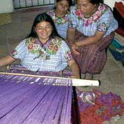 Cojolya weavers María Tiney, María Sosof and Concepción Queju demonstrate the backstrap loom weaving process.
