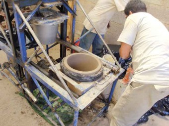 A step in the process: clay and pine sawdust are poured into molds