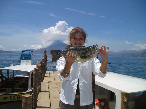 Karla S. is among the many anglers who frequent the Panajachel piers for bass.  (photo: Brennan Harmuth)