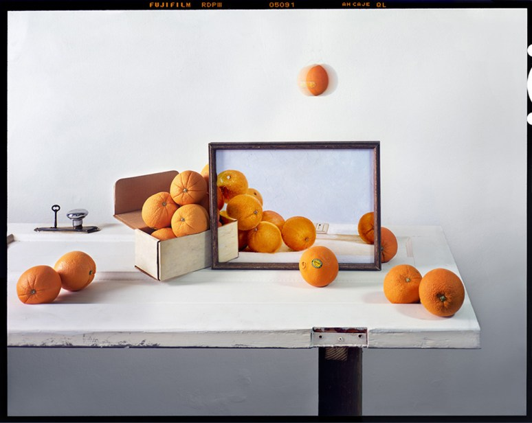 Oranges, Box and Painting on Door © John Chervinsky