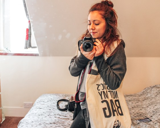 Natali Dimitri, a BA (Hons) Media student at RGU clicking a picture of herself on the mirror.