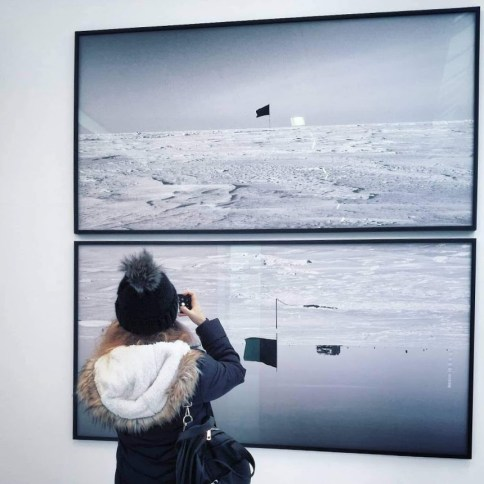 Natali Dimitri, a BA (Hons) Media student at RGU, clicking a picture of a painting.