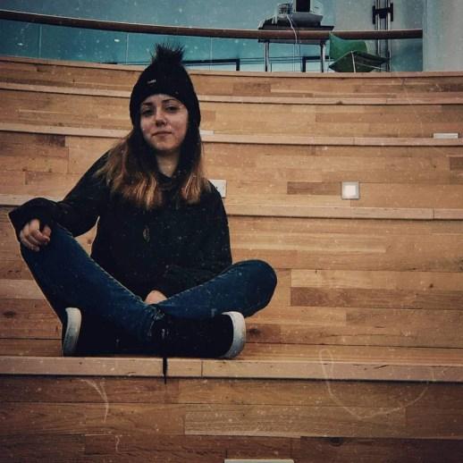 Natali Dimitri, a BA (Hons) Media student, sitting in the RGU Campus