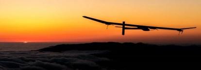 solar-impulse-2-plane-flying-at-night-photo-wallpaper-luggage-online-1024x360