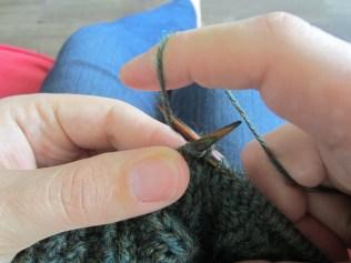 Throw the yarn around the needle