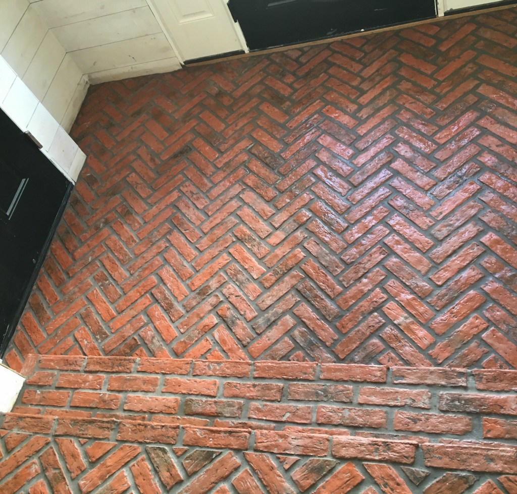 herringbone brick entryway floors