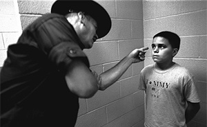 Officer intimidates kid