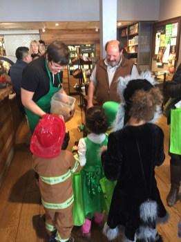 Polk St merchants handing out treats to the kids.
