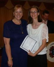 Assistant Principal Mrs. Patton presents Natalie Ellard with a leadership award