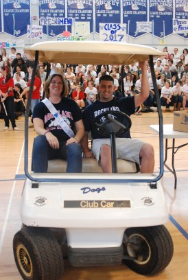 Ms. Rockland High getting her own ride around the gym with gym teacher Mr.Doyle. Mr. Bigsby who was chosen as Mr. Rockland was not present for the rally on Friday.