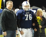 Senior captain Ethan Rooney and his mom and dad.