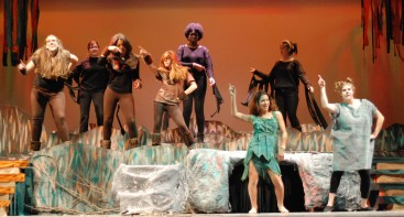 Olivia Olsen (Baloo) on the right leads Mowgli and the Jungle animals in Jungle Boogie dance.
