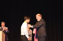 Valedictorian Jon Soo Hoo accepts his medal from Superintendant John Retchless.