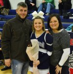 Maddie Daly with her parents.