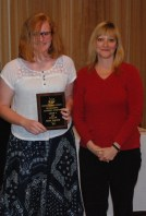 Freshman Eden Dalton with her award for Art and English academic achievement presented by Mrs. Shaw.