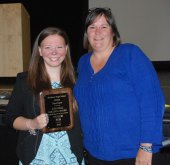 Taylor Reis was presented with the John Bell Bulldog Award by her softball coach Sharon McGonnigal.