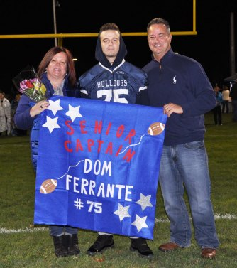 Captain Dominic Ferrante with his parents Susan and Mike