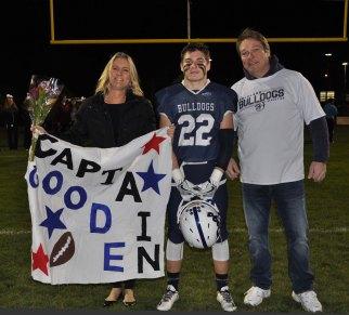 Captain John Goode with his parents Kim and John