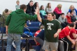Anthony Ambrose gets a high five from Coach McGuiness photo courtesy of William Marquardt