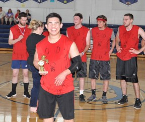 Justin Nguyen is awarded the MVP trophy. photo by Julian Tarpey
