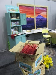 Sumner's beautiful booth was a team effort. The fresh rhubarb is from Leslie & Son, the photo of Mt. Rainier was from City employee Derek Barry, printed so beautifully by Northwest Autowraps, a Sumner company, and framed masterfully by the Public Works Shops.