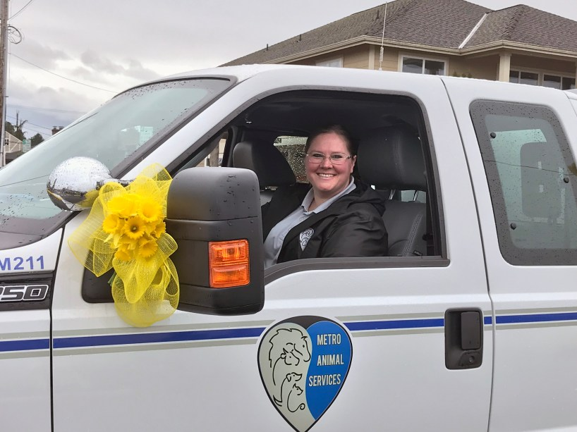 Officer Thawsh celebrates Metro Animal Service's mission to Shelter, Protect and Unite pets in Sumner, Puyallup and other cities.