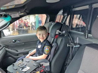 Sumner Police's Chief for a Day, Reid, is ready tor roll through the parade with Chief Moericke.