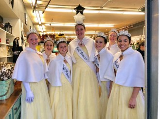 The Daffodil Princesses pop into one of Sumner's downtown stores to escape a rainy day.