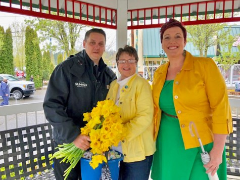 Councilmembers Reed, Hayden and Pederson duck a rainstorm in Heritage Park's gazebo.