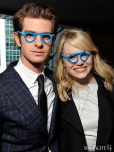 Emma Stone and Andrew Garfield, wearing pipecleaner glasses