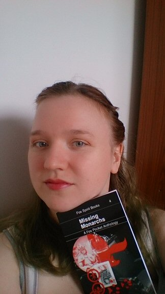 Me, posing with my copy of Missing Monarchs