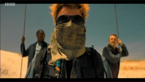 A screenshot from Doctor Who that strongly evokes Mad Max: Fury Road.