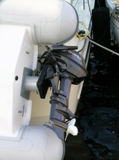 Rotating outboard motor mount