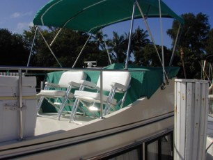 Flybridge cover with folding chairs