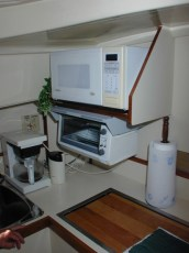 Toaster oven mounted under microwave shelf
