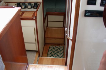 Custom storage box placed under second drawer in V-berth