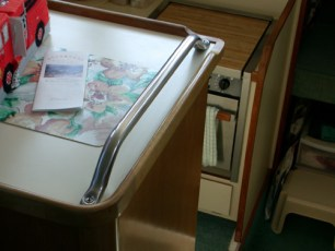 Custom hand hold at stairs to galley/v-berth/head