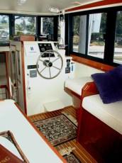Custom mahagony salon seating and storage folding helm seat