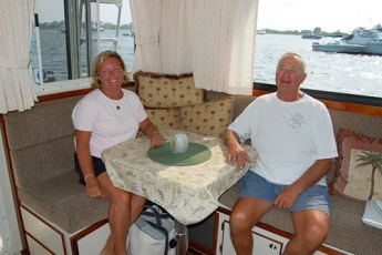 Owners Beth and Cal sitting around their custom table
