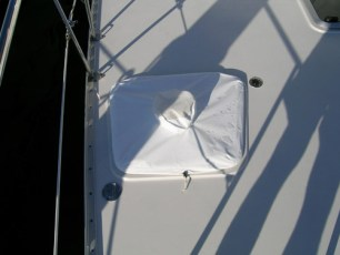 Hatch cover over port side with vent