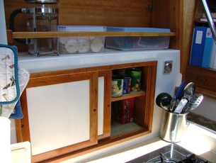 Additional galley storage over stove top