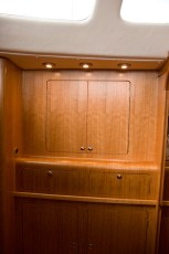 Custom built vanity in place of opening hatch in starboard hull