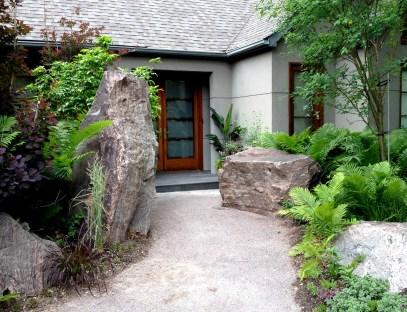 Towering rocks at a front door