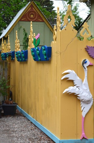 A fence is finished with sculptural details