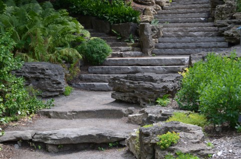 A stone staircase accented with sculptural boulders.