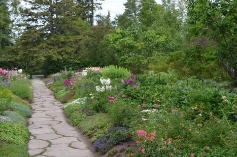 A long formal flower bed framed by forest at Reford Gardens.