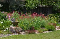 A flower bed with river rock mulch at Keppel Croft.
